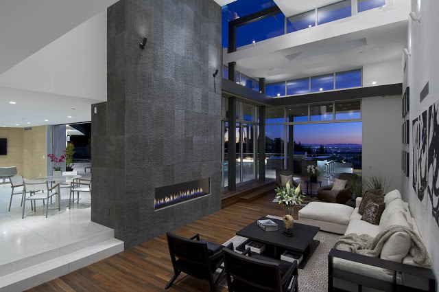 double height living room interior design 1734 Doheny - Cliff View Modern Home In Hollywood Hills, California by Luca Colombo