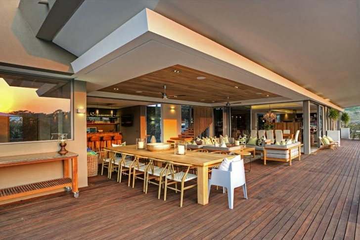 huge dinning area Albizia House - Cliff View Modern Mansion by Metropole Architects homesthetics (1)