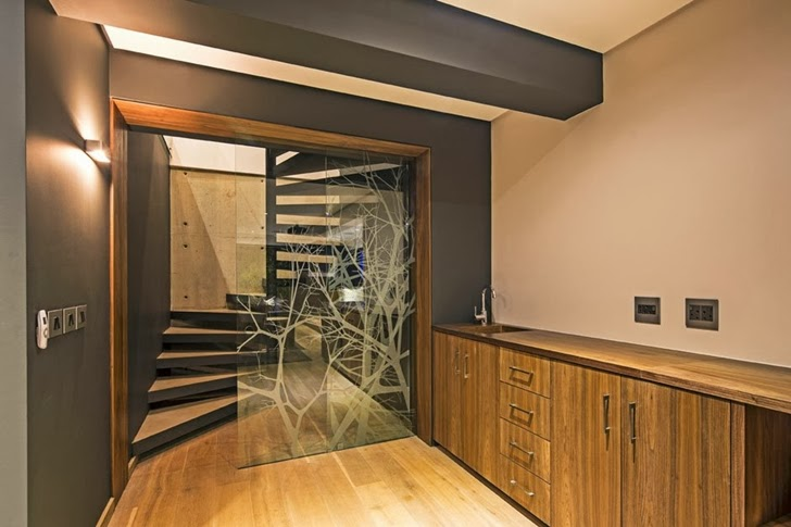 staircase access Albizia House - Cliff View Modern Mansion by Metropole Architects homesthetics (1)