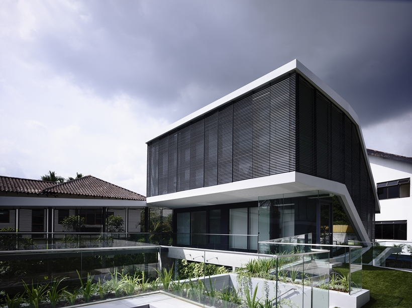 angled view of the Andrew-Road-Residence-Futuristic-Dream-Mansion-Dream-in-Singapore-by-A-DLAB-modern-mansion