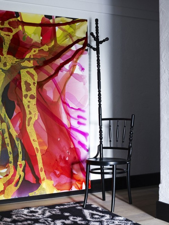Contemporary Black Interior Design with Vibrant Accents colorful painting