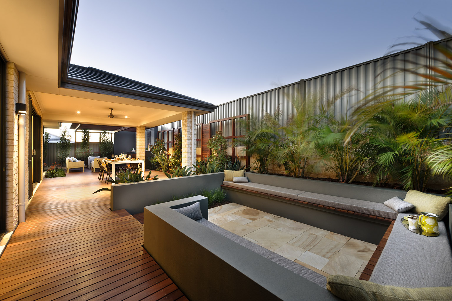 exterior space designed for a Centered Conversation Social Pit -Sunken Sitting Areas to Fit Your Modern Mansion