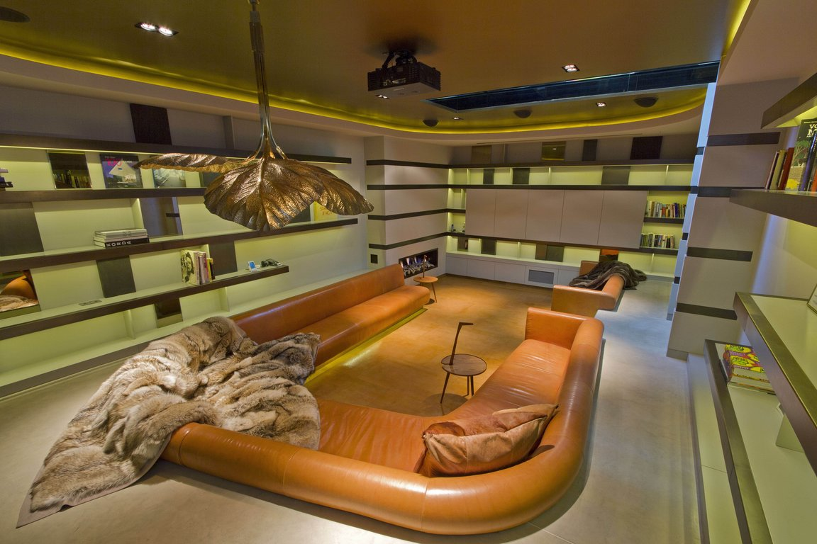 orange leather Centered Conversation Social Pit -Sunken Sitting Areas to Fit Your Modern Mansion