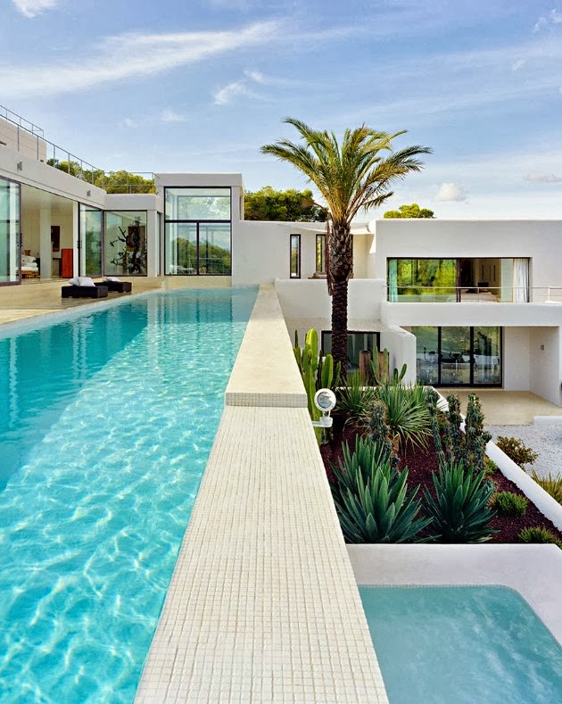 mutiple terraces with infinity swimming pools in the Cliff View Modern Ibiza Dream Home Envisioned by Jaime Serra in Spain