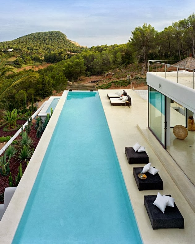 long swimming pool and pastio Cliff View Modern Ibiza Dream Home Envisioned by Jaime Serra in Spain