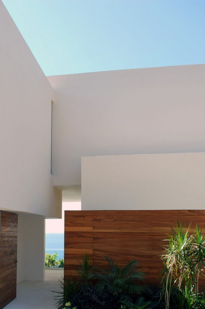 detail shit of the Cliff View Modern Mansions with Multiple Terraces Overlooking the Beach- Finestre Villas by CC Arquitectos