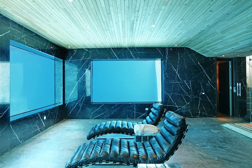 cinema room in the Cliff View Modern Spa House in Cape Town, South Africa by Metropolis Design