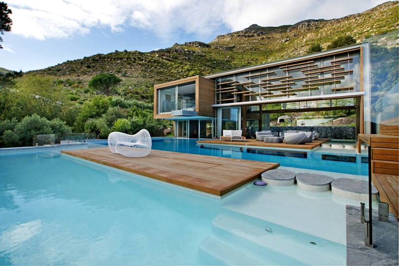 infinity swimming pool in the backyard landscaping of the Cliff View Modern Spa House in Cape Town, South Africa by Metropolis Design