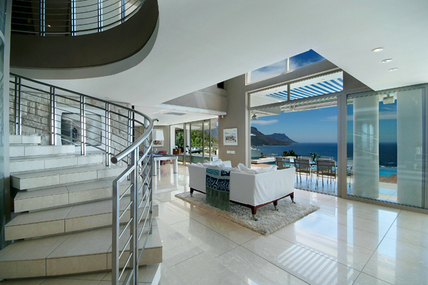 living room interior design with expansive views Clifton-View-Luxurious-Mansion-NettletonRd-South-Africa