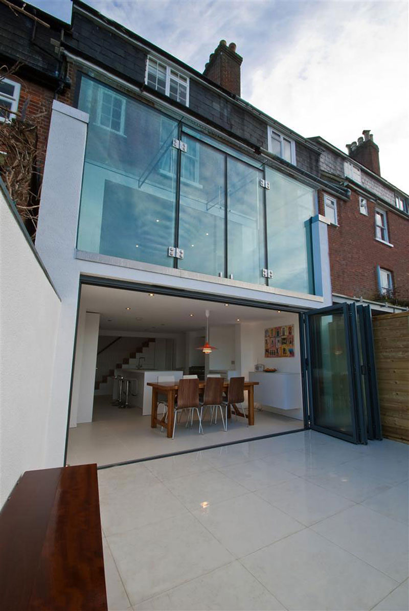 glass opened Clifton View Mansion Glass Extension in England by AR Design Studio
