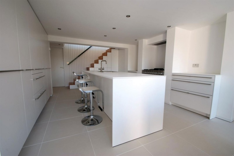kitchen interior design with bar in white stark Clifton View Mansion Glass Extension in England by AR Design Studio