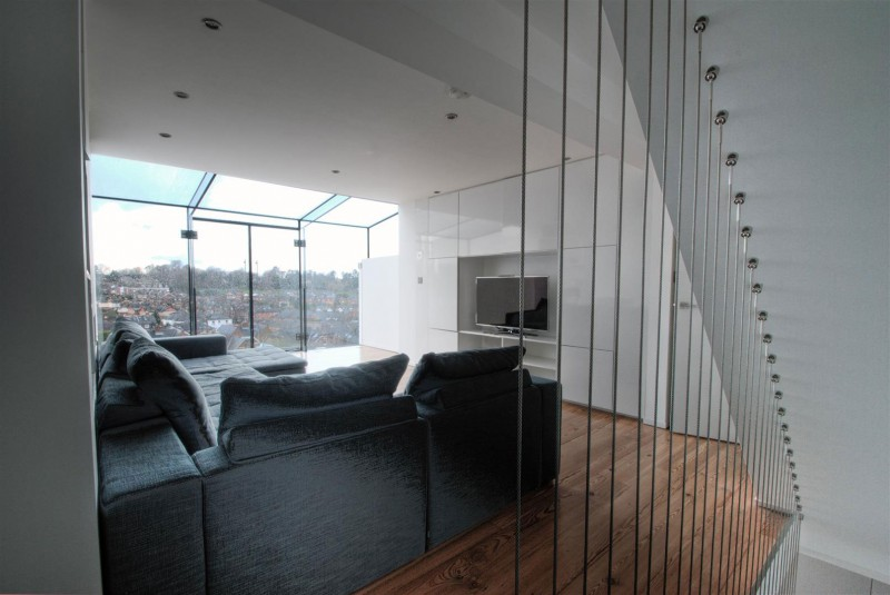 black and white living room with Clifton View Mansion Glass Extension in England by AR Design Studio
