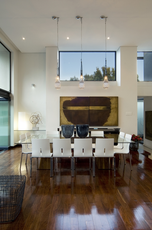 dinning area of the Dream Home Close to Achieving Perfection- House Mosi by  Nico van der Meulen Architects