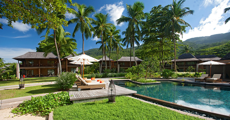 high end terrace patio with palm trees and luxury Ephelia Resort in Seychelles -Living Large in a Drop of Heaven