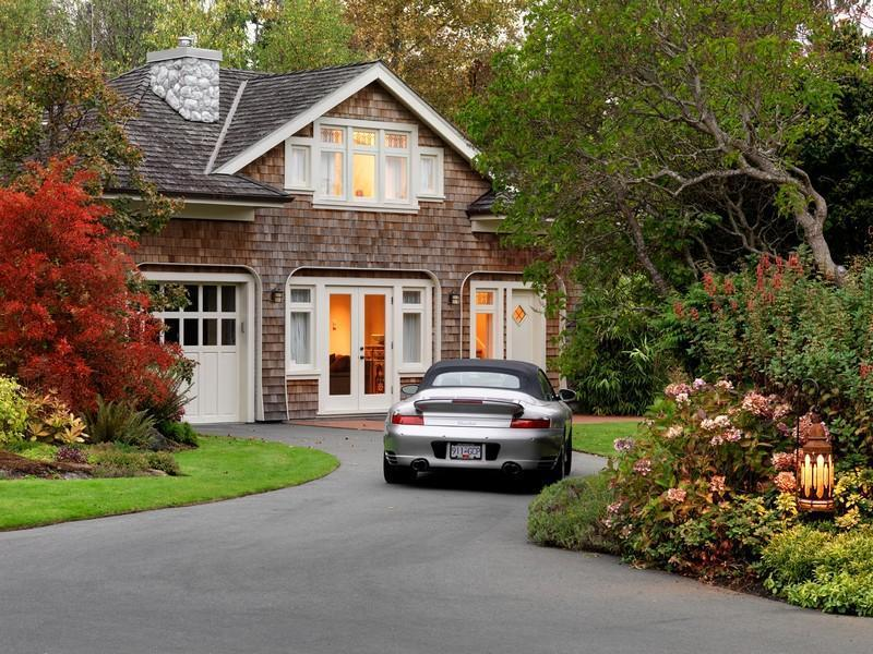 porsche on the lawn of Extravagant Luxurious Waterfront Mansion with Serene Surroundings