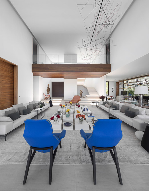 large living room with blue accents in Jaragua Residence - Luxurious Modern Mansion in São Paulo, Brazil