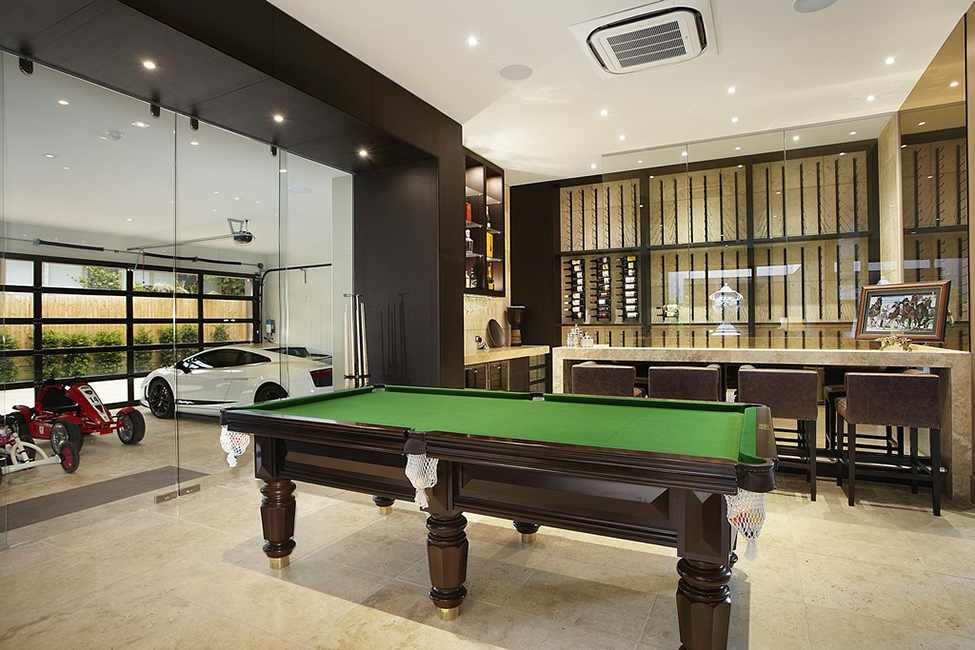pool table in black and white interior design Large Luxurious Modern Mansion in Melbourne Wearing Contemporary Style