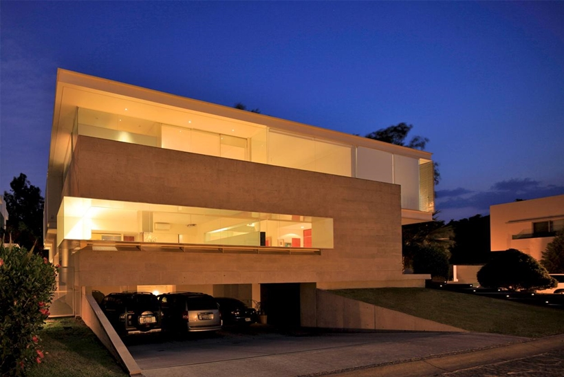 pedestrian perspective at night Luxurious Modern Mansion with Huge Cantilever in Contemporary Style - Godoy House in Mexico