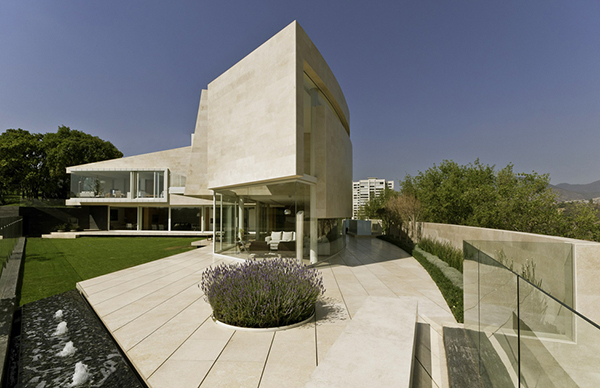access Marble-L-Shaped-Modern-Mansion-with-Amazing-Backyard-Landscaping