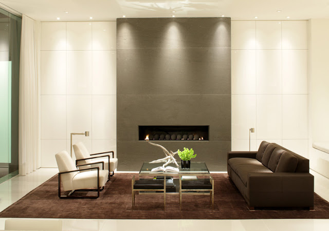 black and white living room interior design with modern grey fireplace