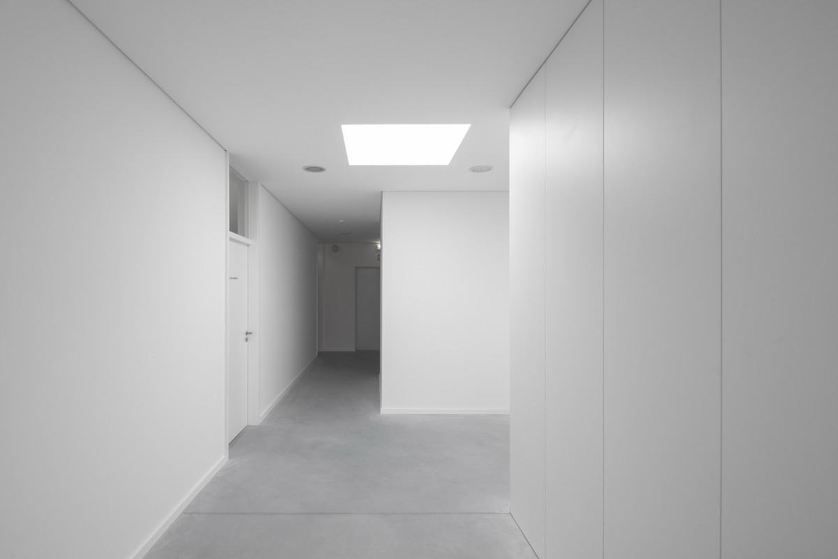 hallway stark white design Minimalist-Private-College-Designed-by-OVAL-Exudes-Contemporary-Style
