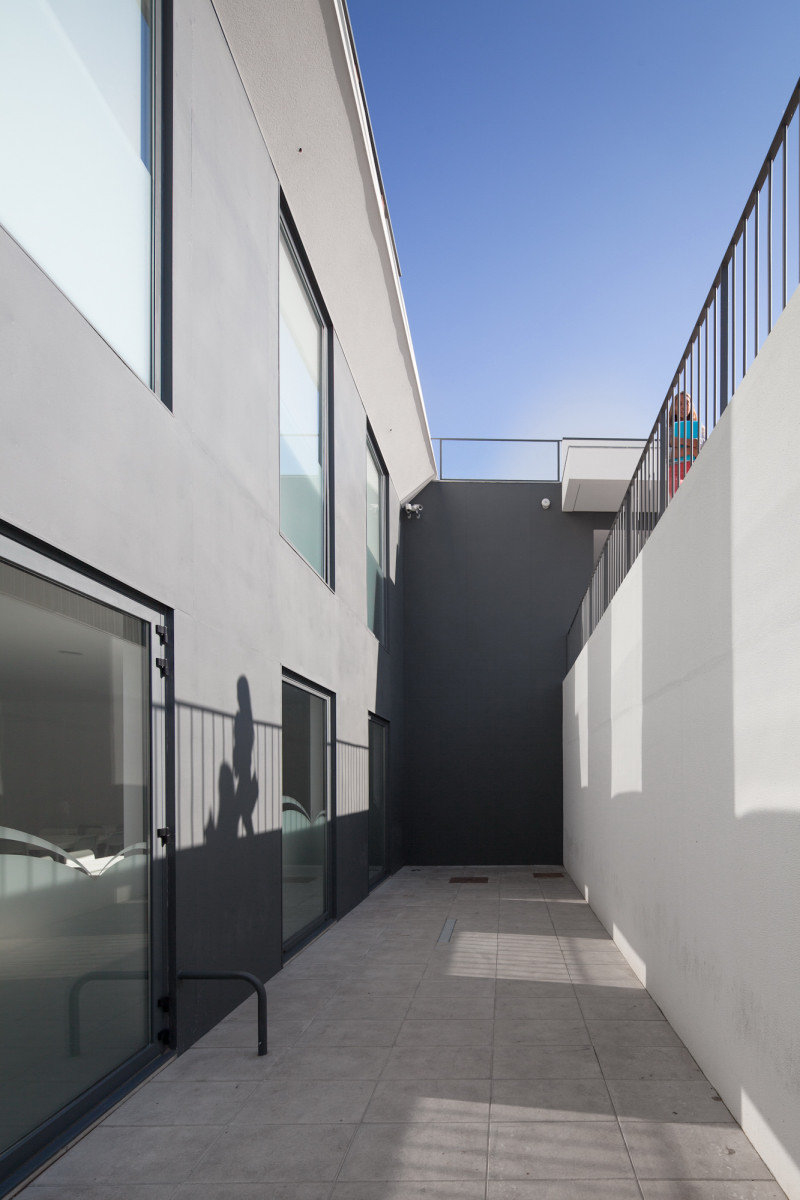 execution detail shot Minimalist-Private-College-Designed-by-OVAL-Exudes-Contemporary-Style