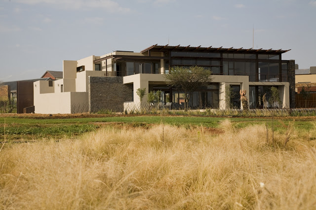 exterior perspective view Modern Jewel Between South African Mansions - Serengeti Houseby Nico van der Meulen Architects