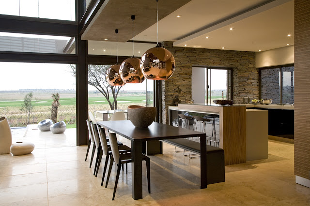 dinning area in the Modern Jewel Between South African Mansions - Serengeti Houseby Nico van der Meulen Architects