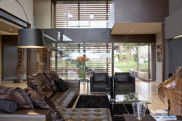 living room interior backyard landscaping Modern Jewel Between South African Mansions - Serengeti Houseby Nico van der Meulen Architects