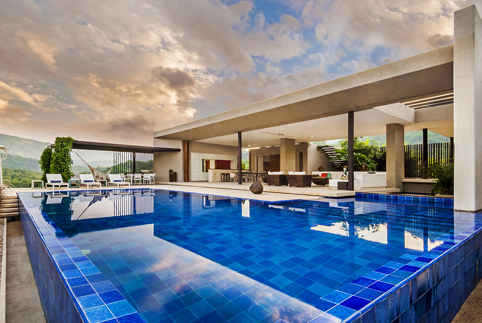 backyard swimming pool design Modern-Mansion-with-Undefined-Boundaries-in-Colombia-by-Arquitectura-en-Estudio