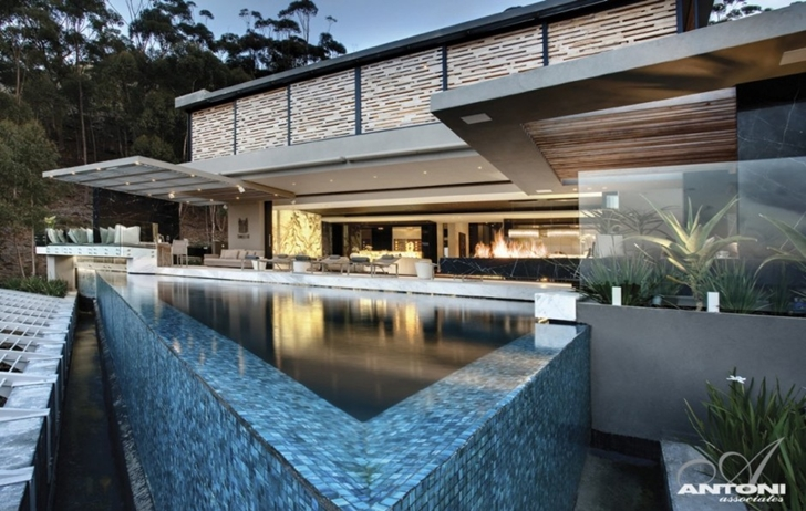 infinity swimming pool Modern Residence on Head Road 1843 by Antoni Associates in Cape Town