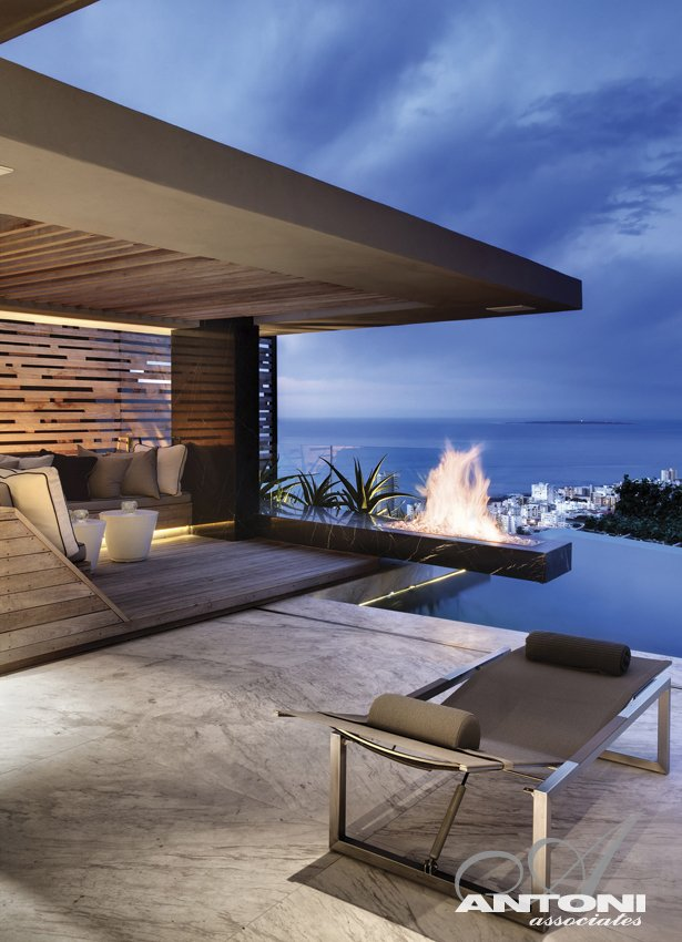 exterior fireplace swimming pool Modern Residence on Head Road 1843 by Antoni Associates in Cape Town