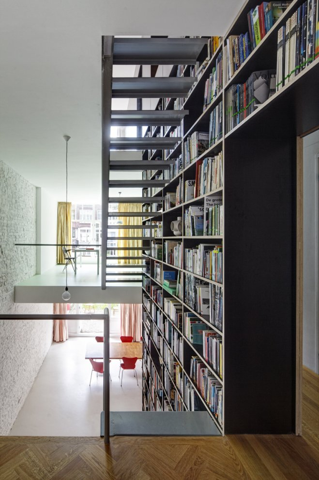 huge bookshelves library Modern Vertical Penthouse in Rotterdam by Shift Architects Preserving Elements of the Old Casco
