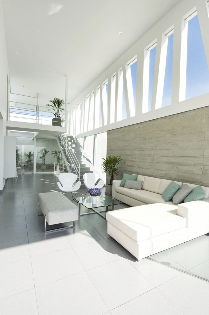 living room interior design Sculptural Dream Vacation Home by RRMR Arquitectos in Asia District of Limas