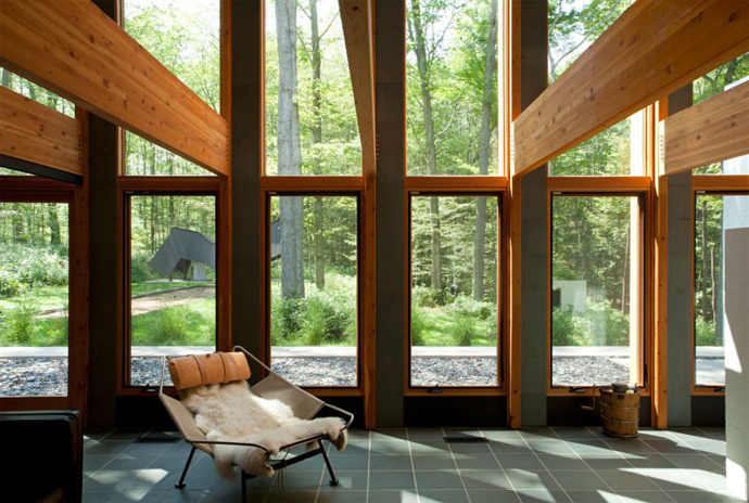 reading knock in the interior design of a Small Modern Mansions in The Forest - Yingst Retreat by Salmela Architect