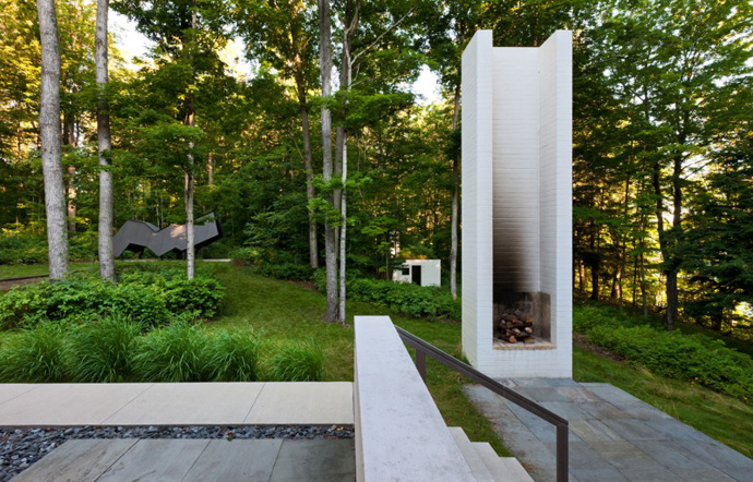 modern exterior fireplace Small Modern Mansions in The Forest - Yingst Retreat by Salmela Architect