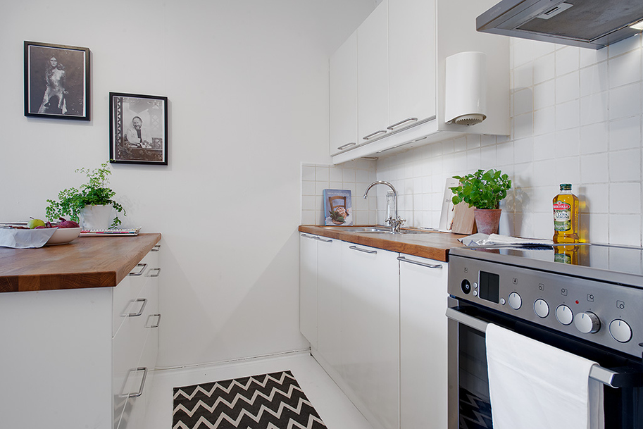 kitchen area Small Single Room Apartment in Black and White - Gothenburg, Sweden
