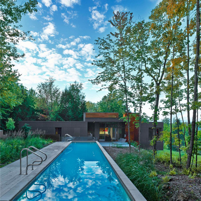 swimming pool and extraordinary backyard landscaping in T House-Modern Mansion by Natalie Dionne Architecture in Sutton, Canada