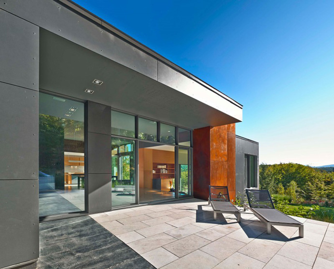 patio area T House-Modern Mansion by Natalie Dionne Architecture in Sutton, Canada