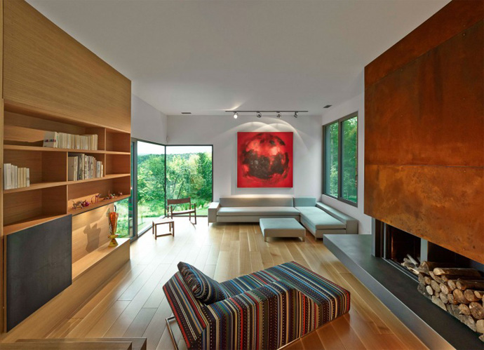 living room interior design with modern fireplace T House-Modern Mansion by Natalie Dionne Architecture in Sutton, Canada
