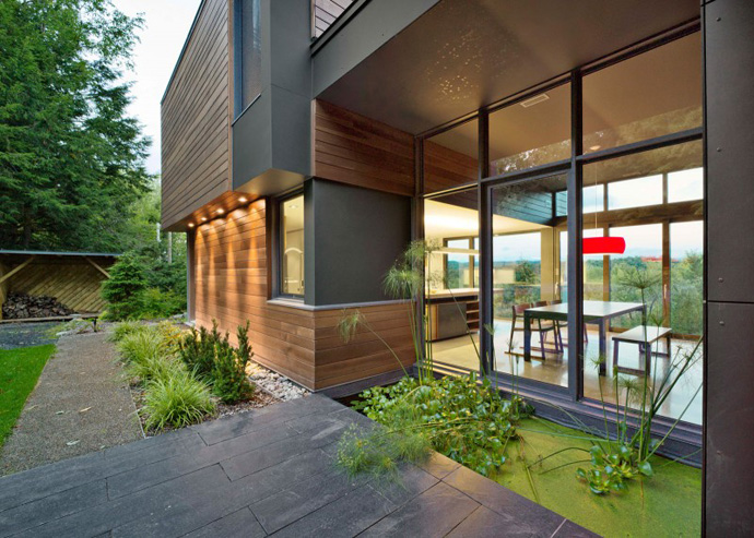 entrance into the T House-Modern Mansion by Natalie Dionne Architecture in Sutton, Canada