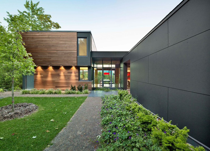 central courtyard access to the home T House-Modern Mansion by Natalie Dionne Architecture in Sutton, Canada
