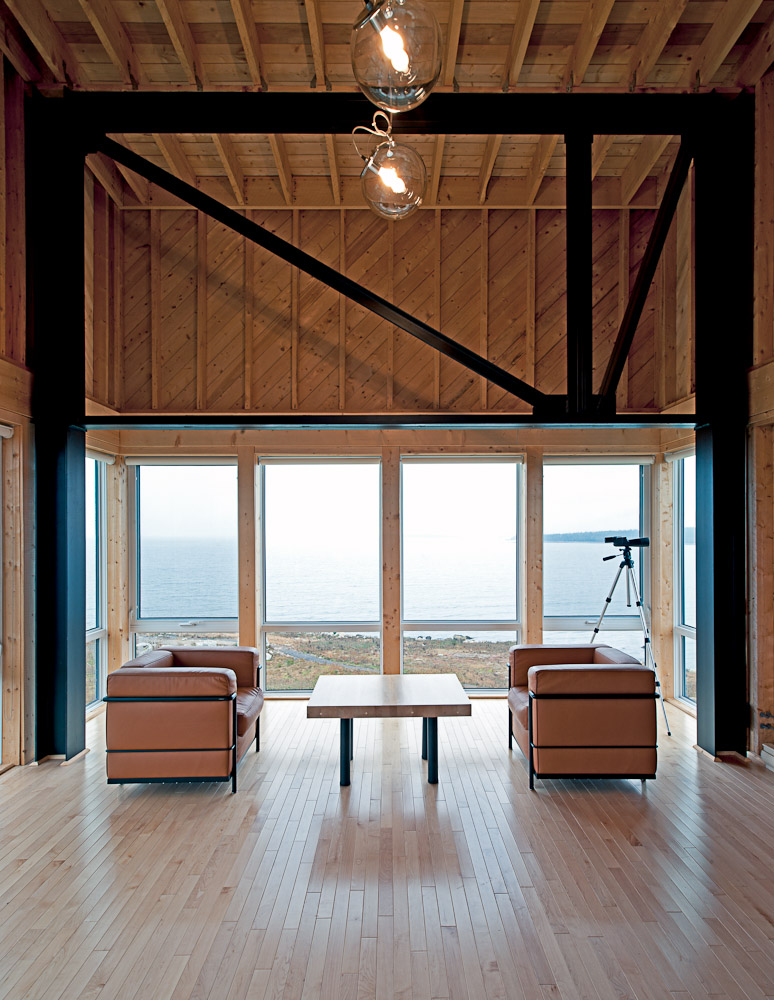 living room interior design Two-Storey Peaceful Retreat -Cliff View House in Nova Scotia homesthetics modern mansion (2)