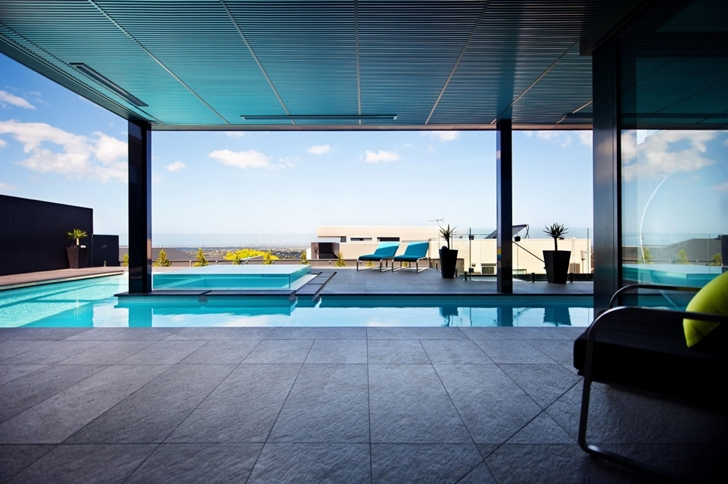 perspective view in the interior of the Wandana Residence - Modern Dream in Black & Blue Overlooking Corio Bay