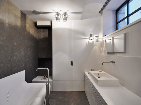 black and white small bathroom in Water Cleaning Station Transformed in a Impecable Modern Mansion homesthetics (1)