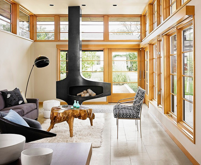 modern fireplace in the Asian Influences in Modern Mansion- Tarrytown Residence by Webber + Studio, Architects