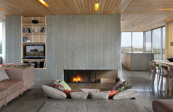 modern fireplace in a breathtaking living room interior design Dune House by JVA - Modern Vacation Home in Suffolk, England