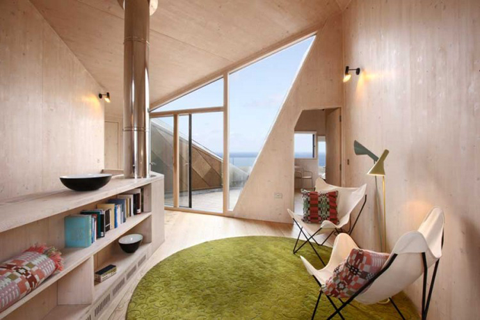 highly unusual library design Dune House by JVA - Modern Vacation Home in Suffolk, England