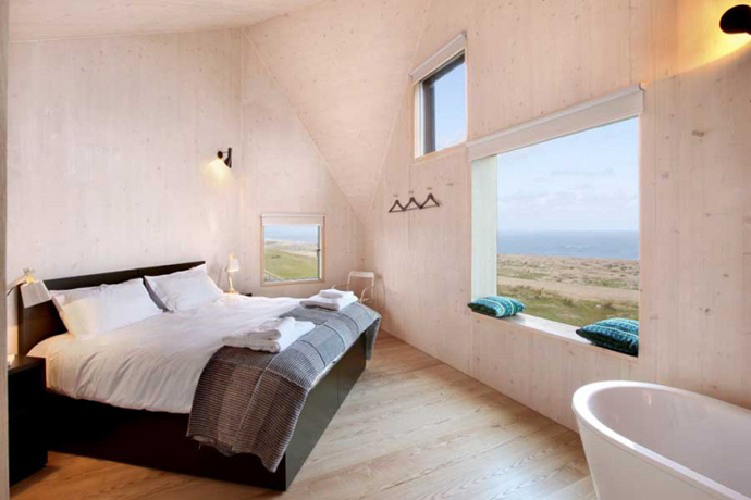 small bedroom interior design Dune House by JVA - Modern Vacation Home in Suffolk, England