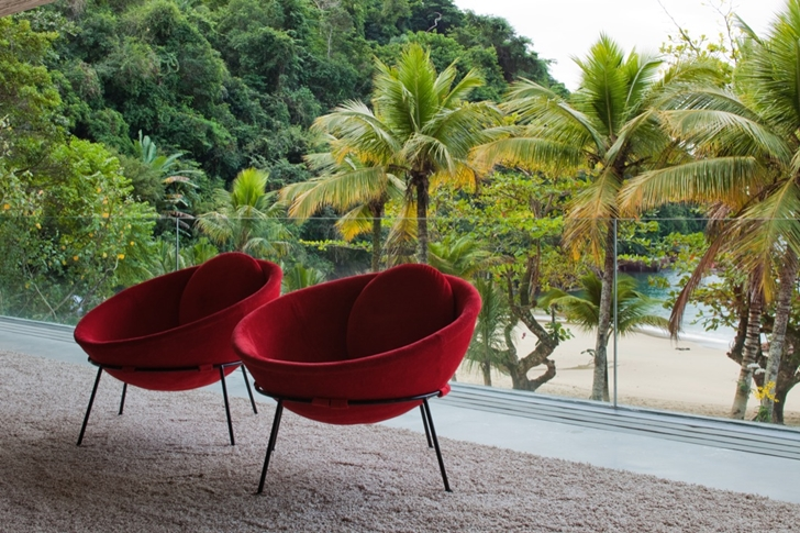 reading knock in the living room Minimalist Modern Beach House in the Wilderness- Paraty House by Marcio Kogan